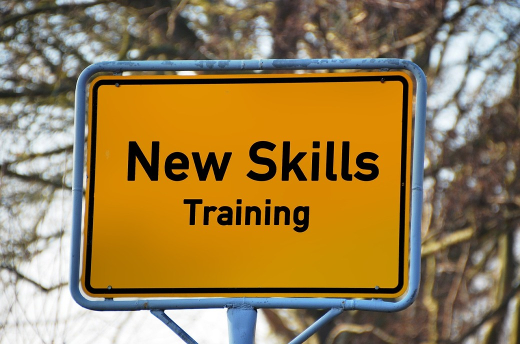 A road sign displaying the text 'New Skills Training'